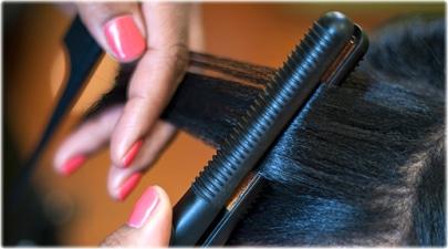 getty_rm_photo_of_woman_having_hair_straightened