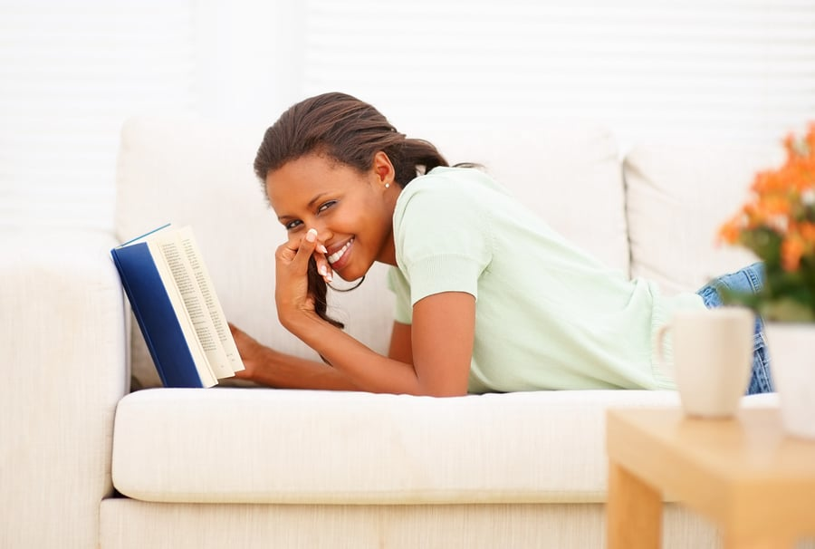 bigstockphoto_young_woman_reading_a_book_re_57523451