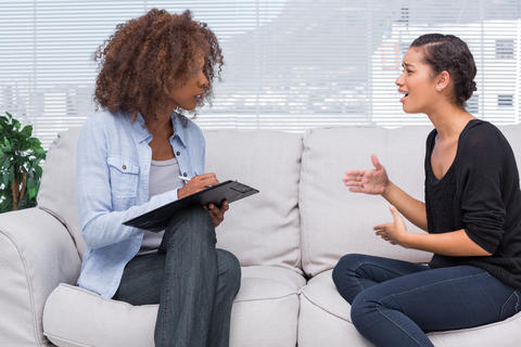 http://www.dreamstime.com/stock-photos-woman-gesturing-speaking-to-her-therapist-who-taking-notes-image31099323