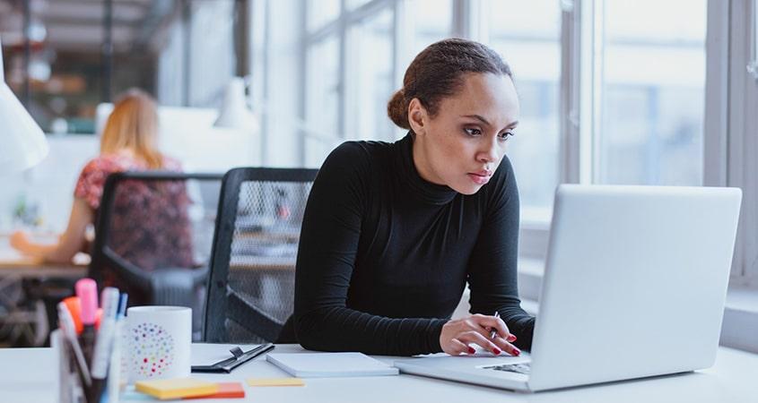 o-black-women-sitting-desk-facebook
