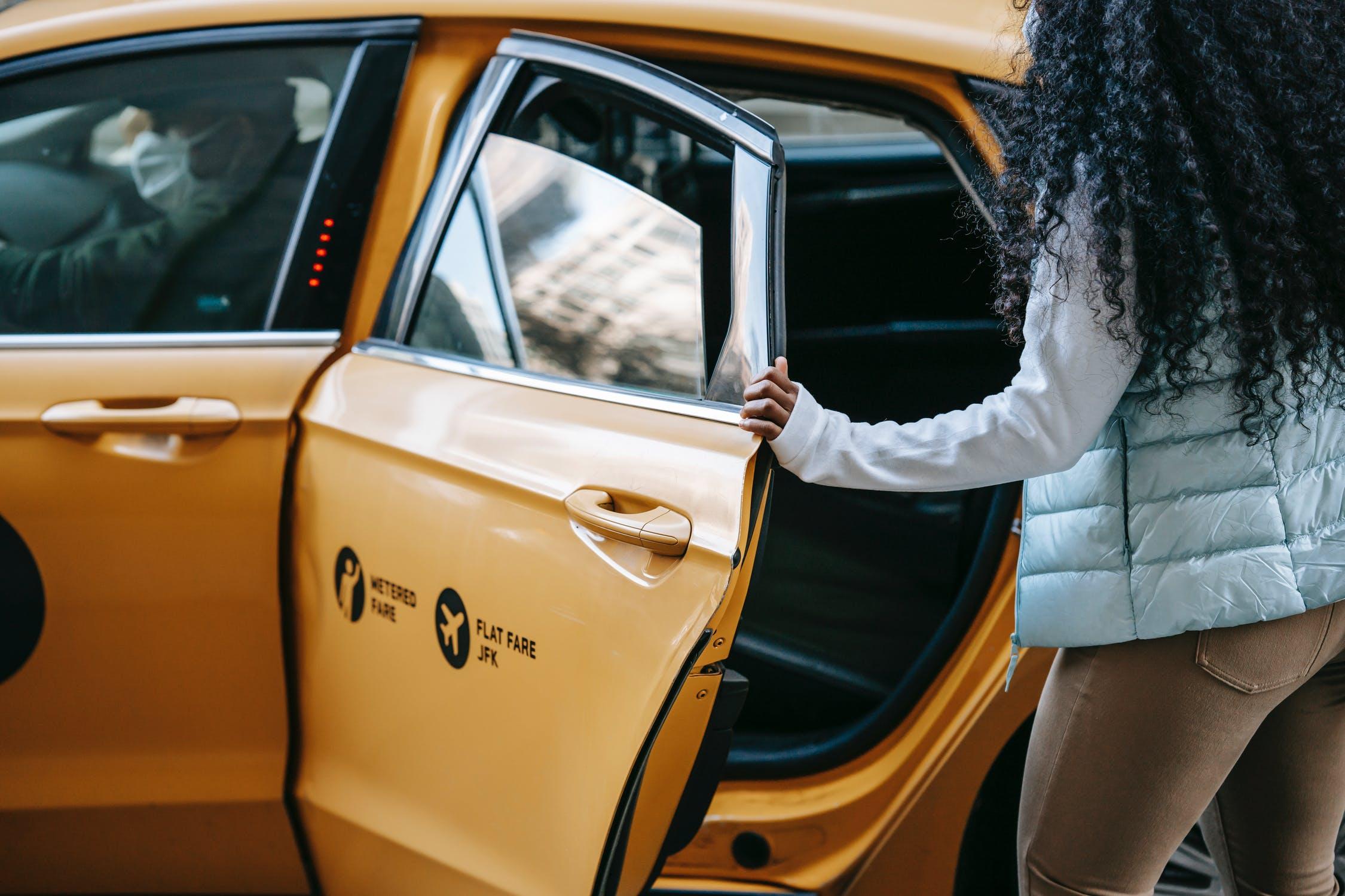 Black woman entering cab