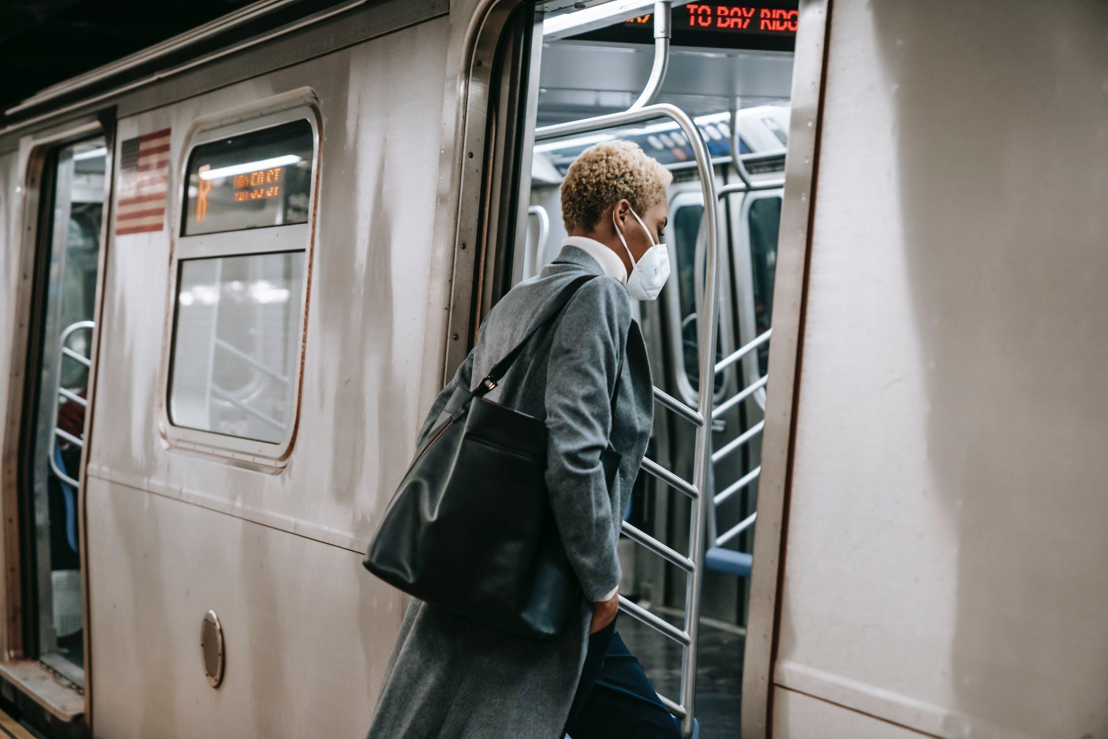 Black woman entering metro train