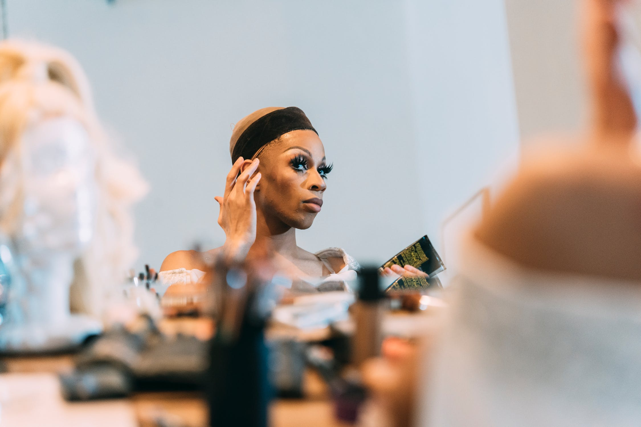 Black woman applying cosmetic products