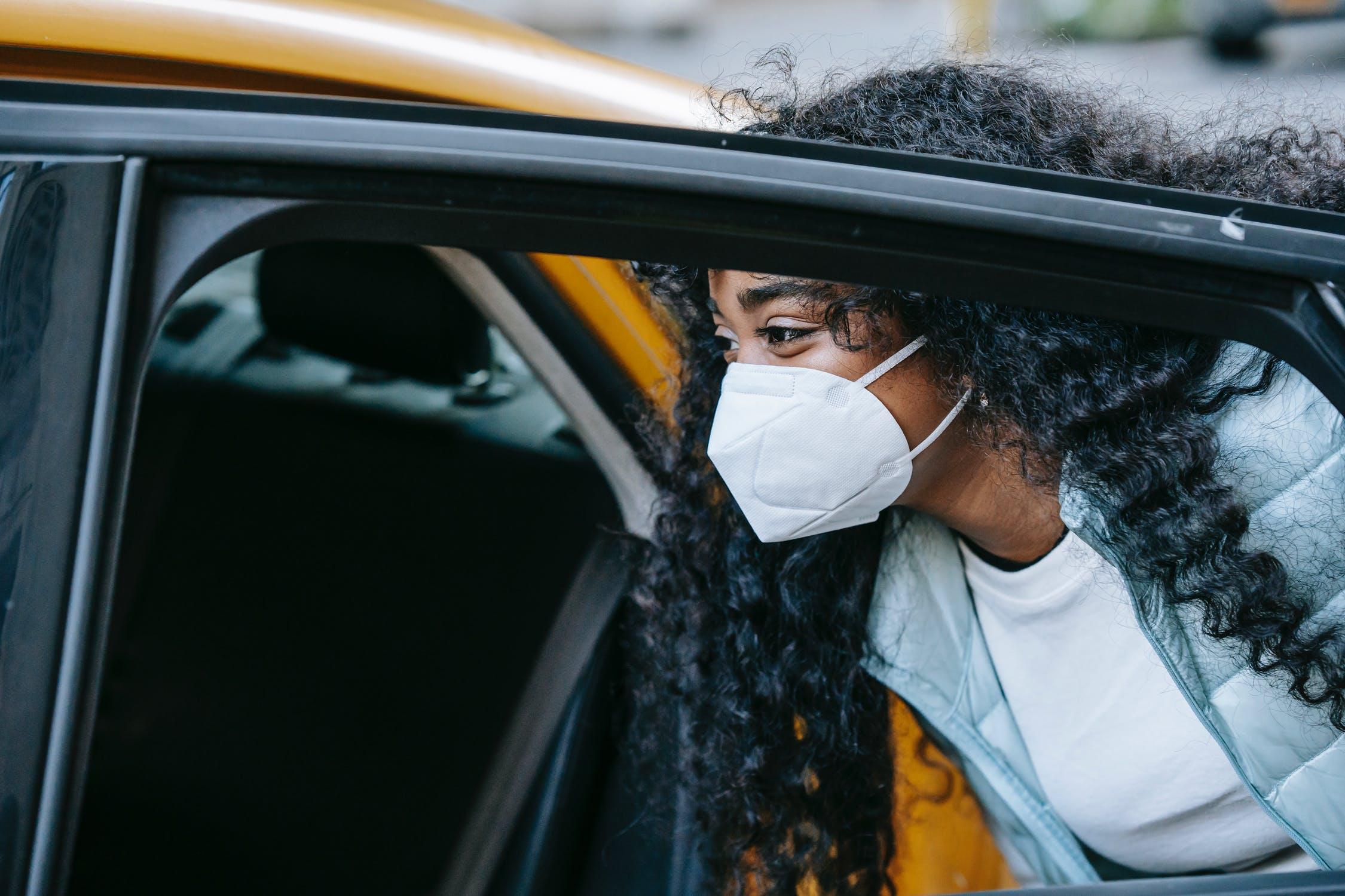 Black woman getting in cab