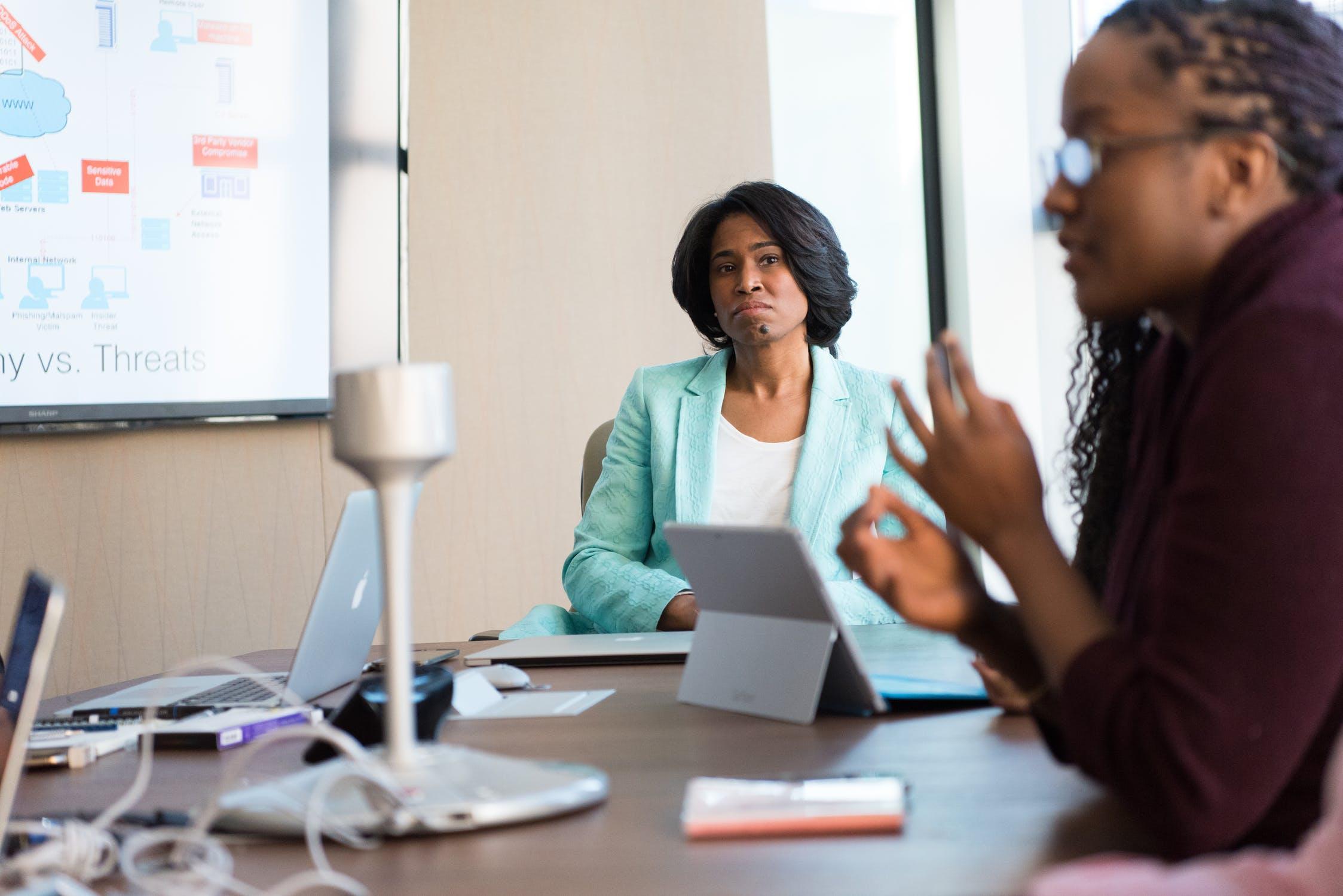 Two Black women working