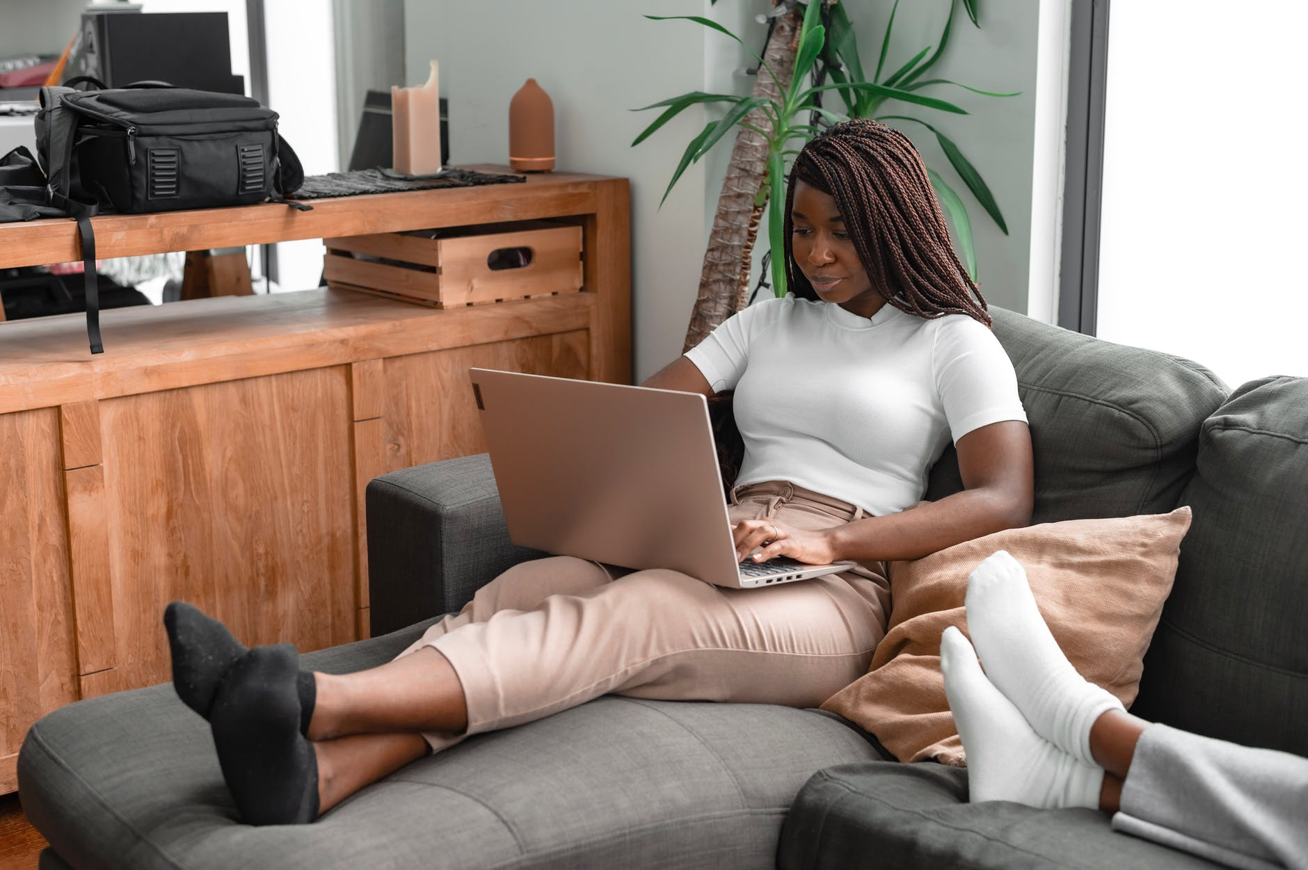 Black woman working on couch