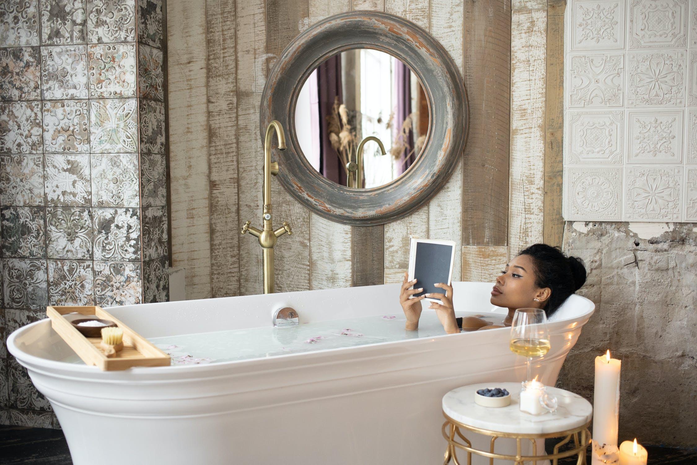 Black woman relaxing in bath tub