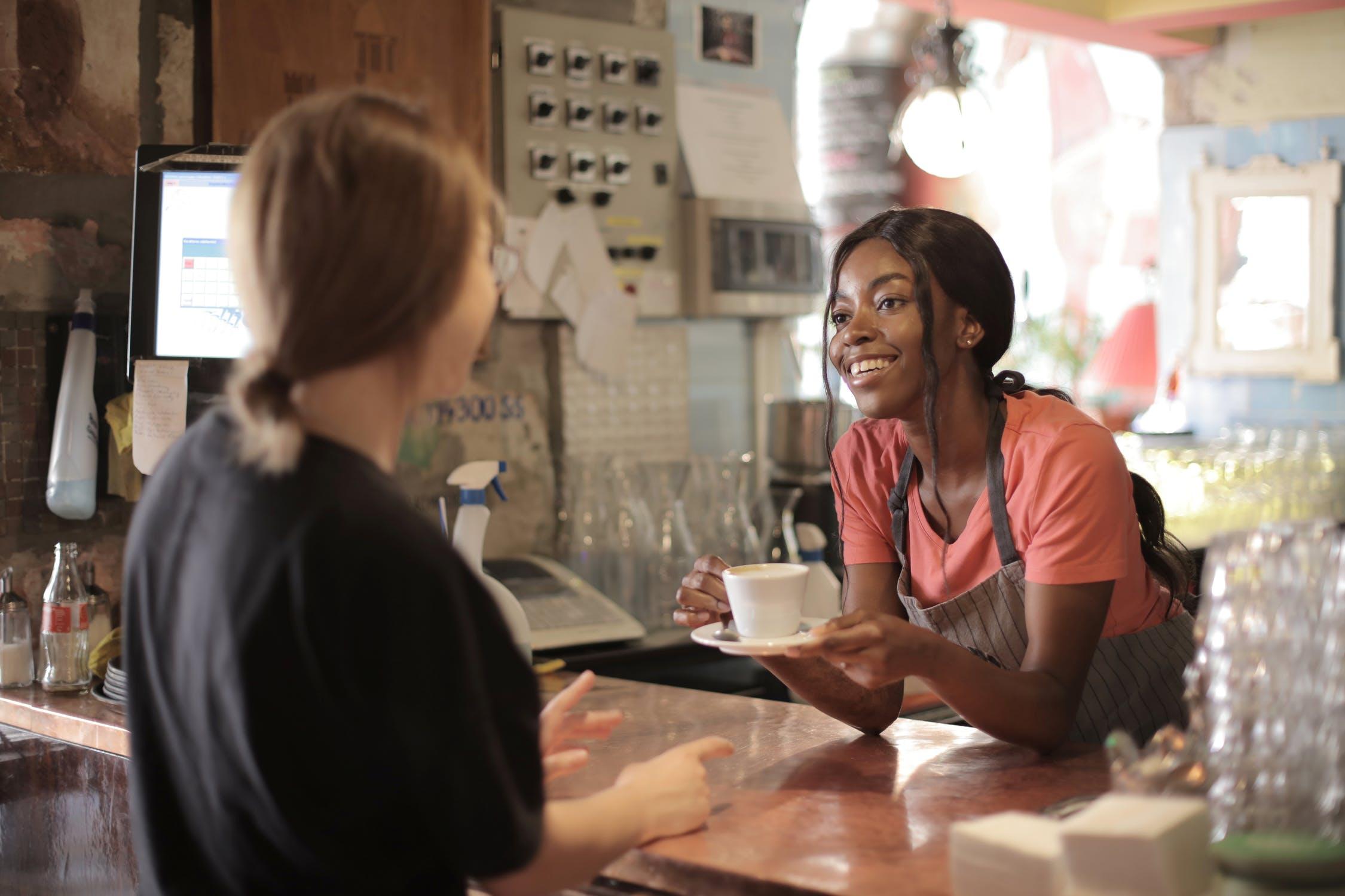 Black woman serving at coffee shop