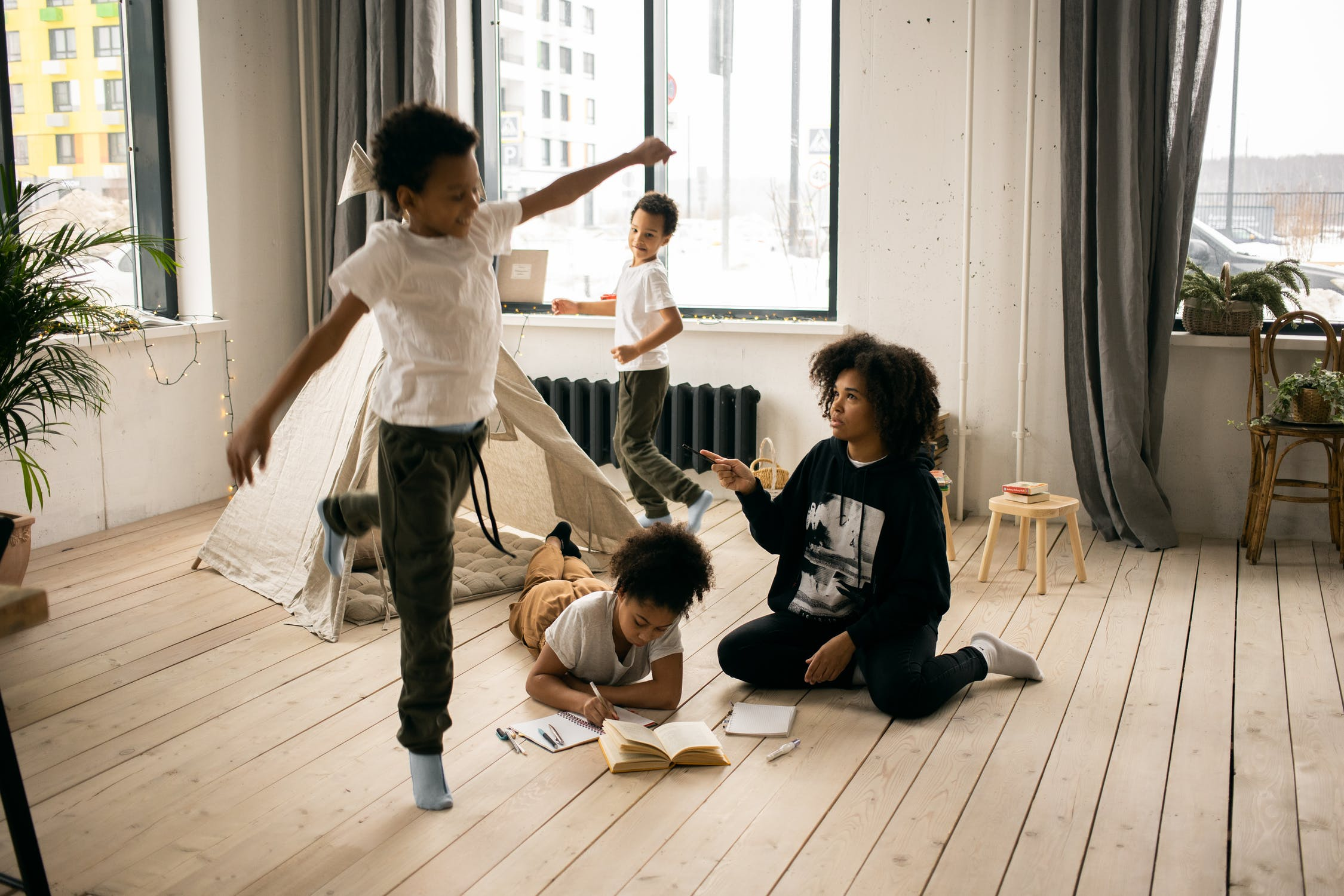 Black family playing in room
