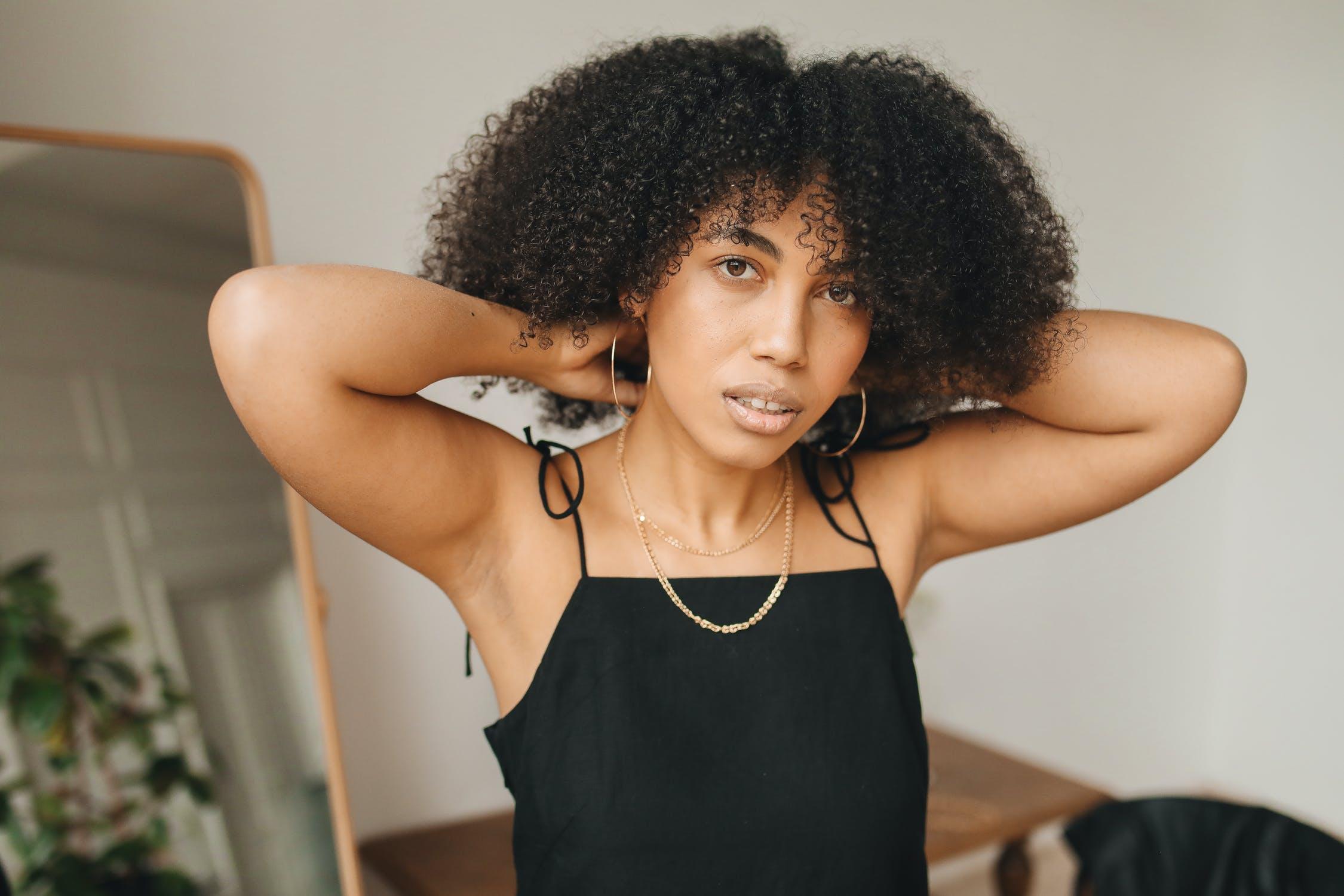 Black woman in black dress