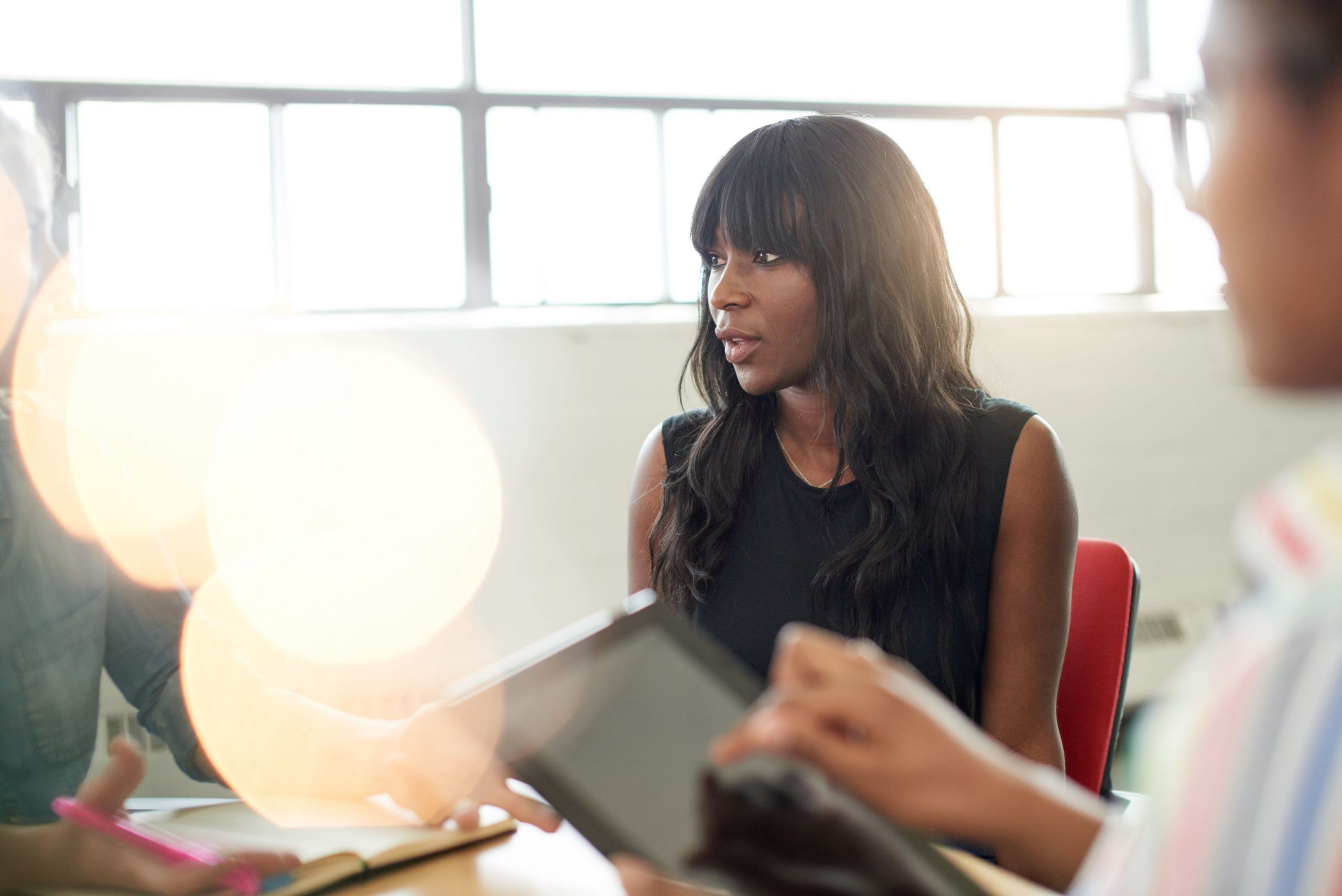 black businesswoman talking in meeting