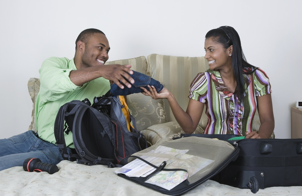 black-couple-packing-travel
