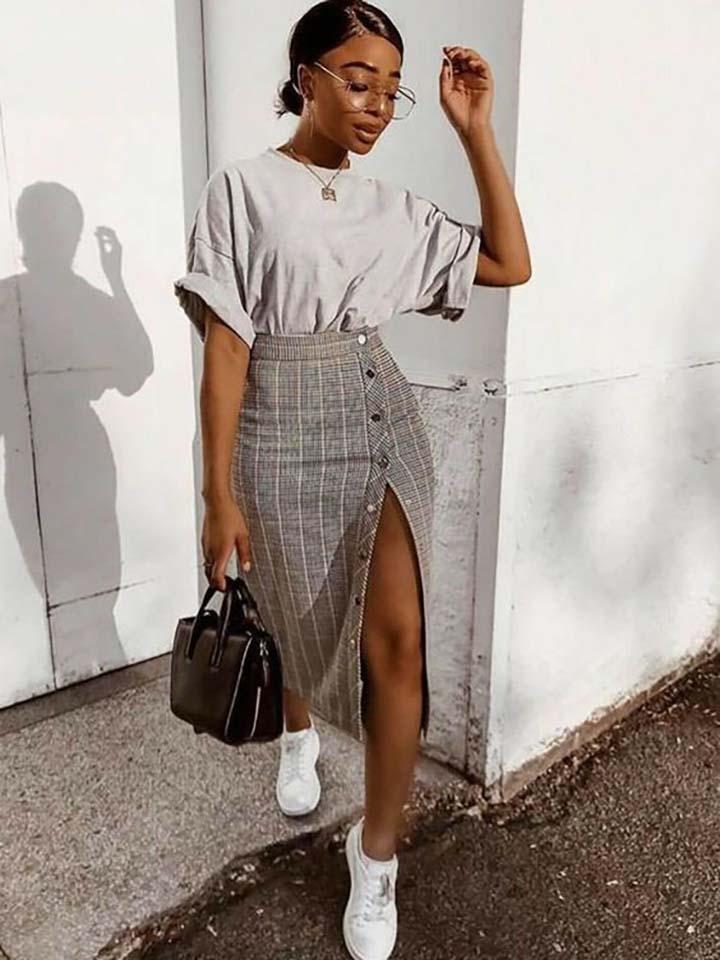 black-woman-fashion-holding-leather-bag