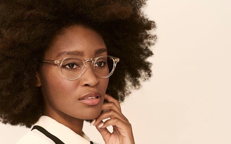 african american woman wearing glasses and thinking