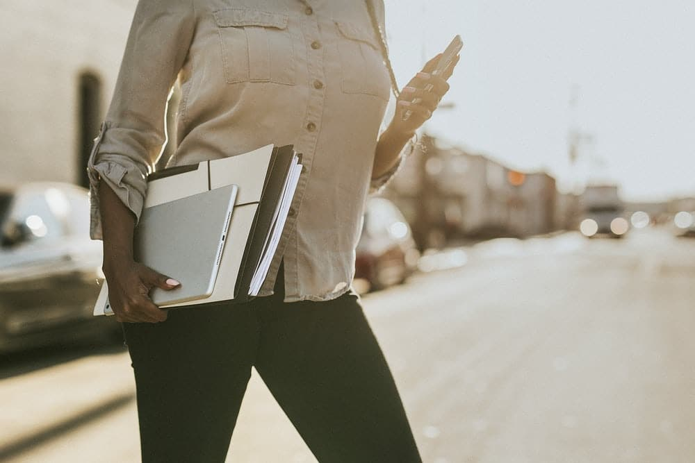black-woman-holding-laptop-work-productivity