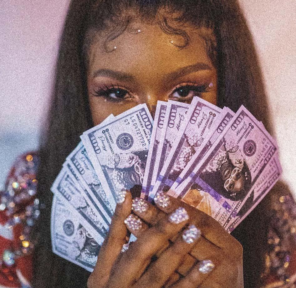 black-woman-holding-money