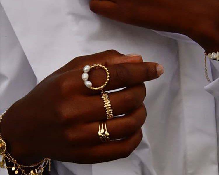 black woman wearing jewelry