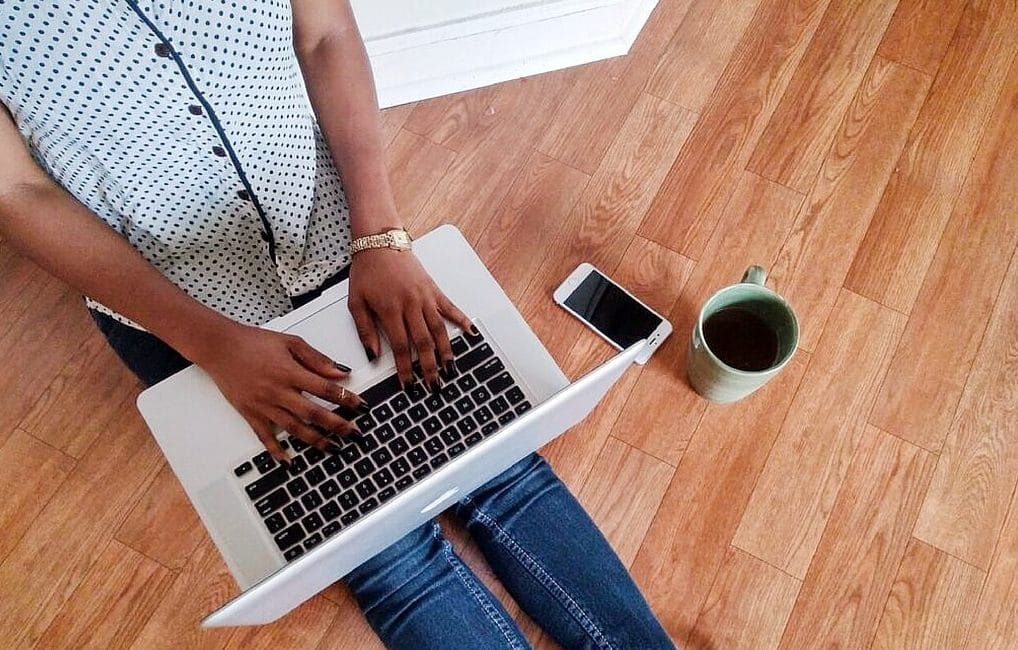 black woman typing on a computer