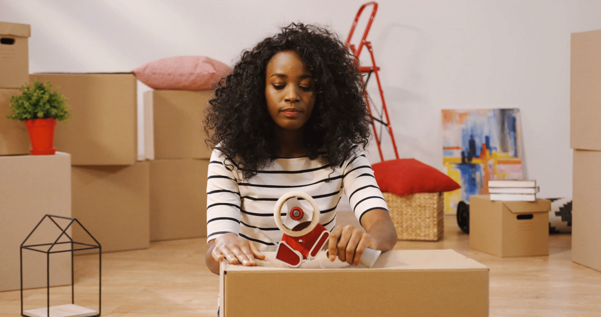 black-woman-packing-moving