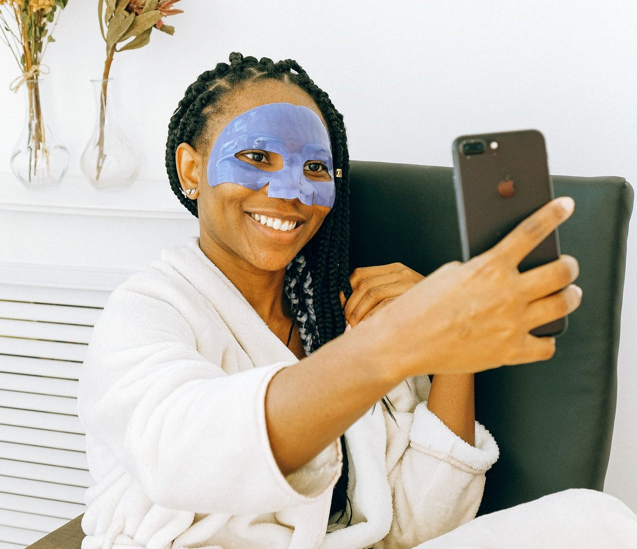 black woman taking selfie on iphone photo