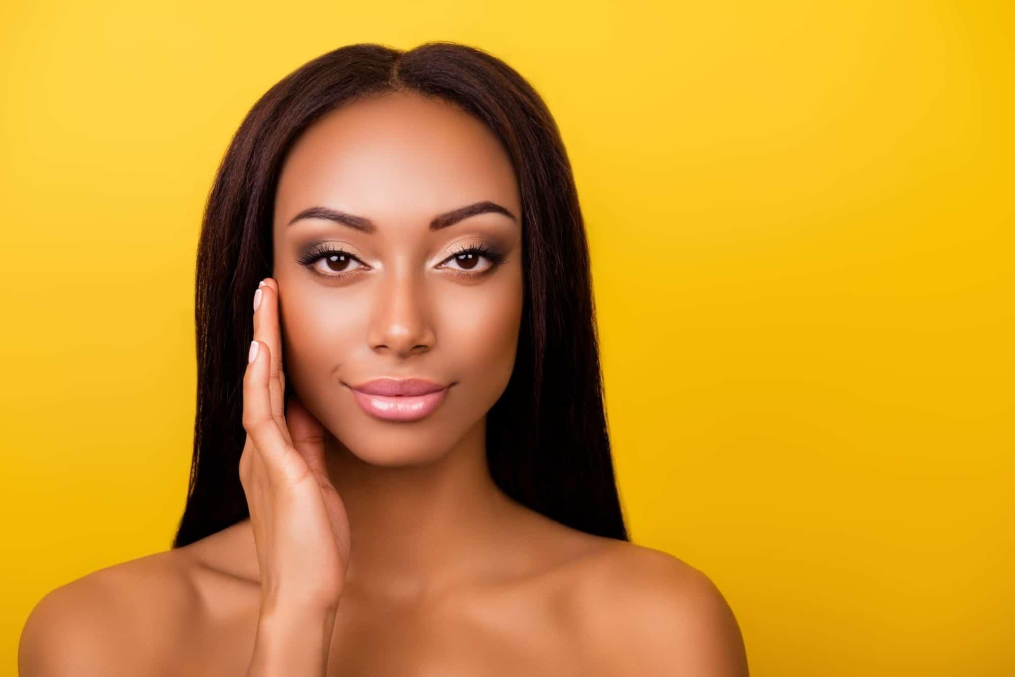 black-woman-touching-skin