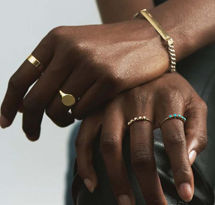 black woman wearing jewelry rings