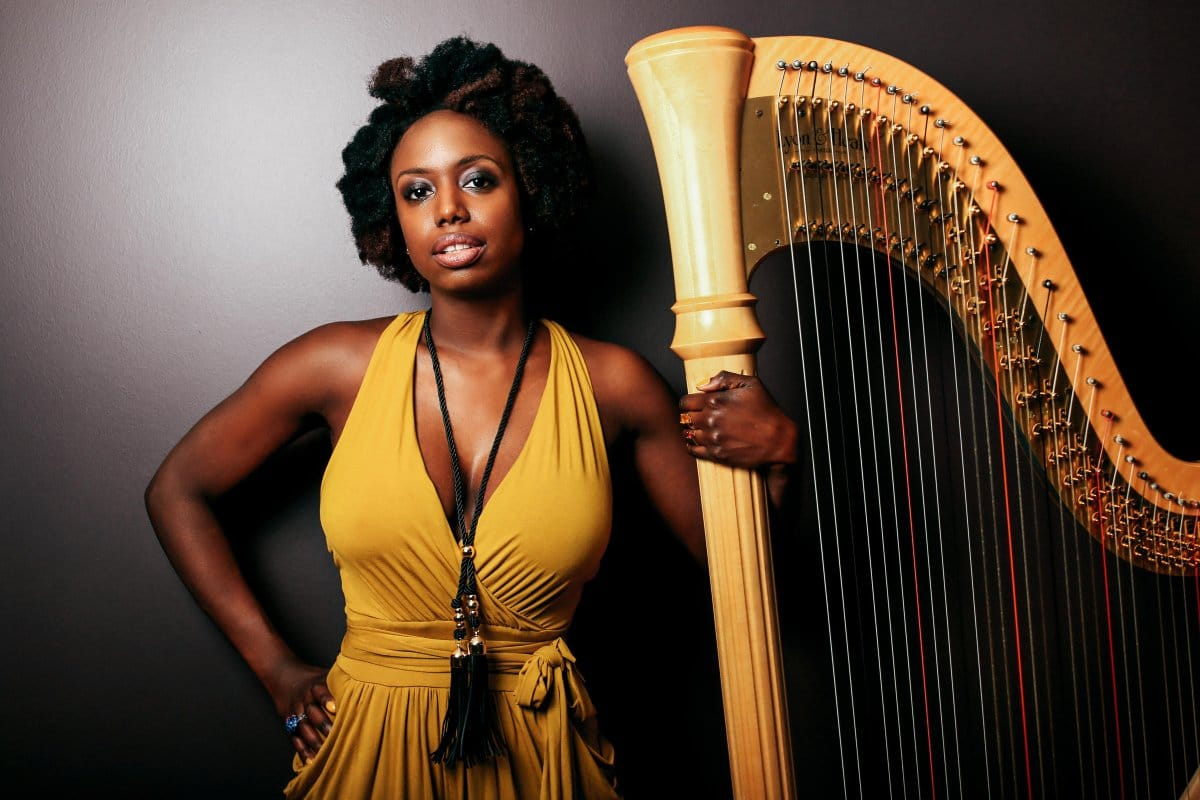 black woman with harp