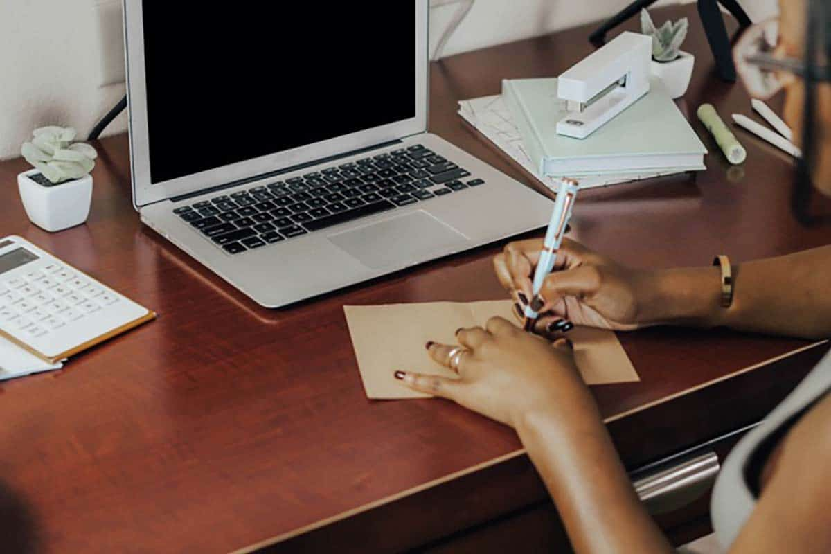 black-woman-writing-at-desk
