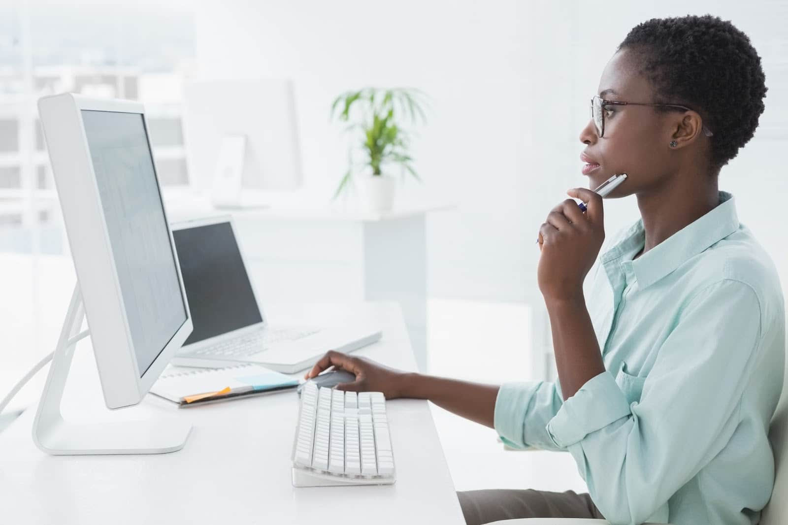 Black woman looking at computer