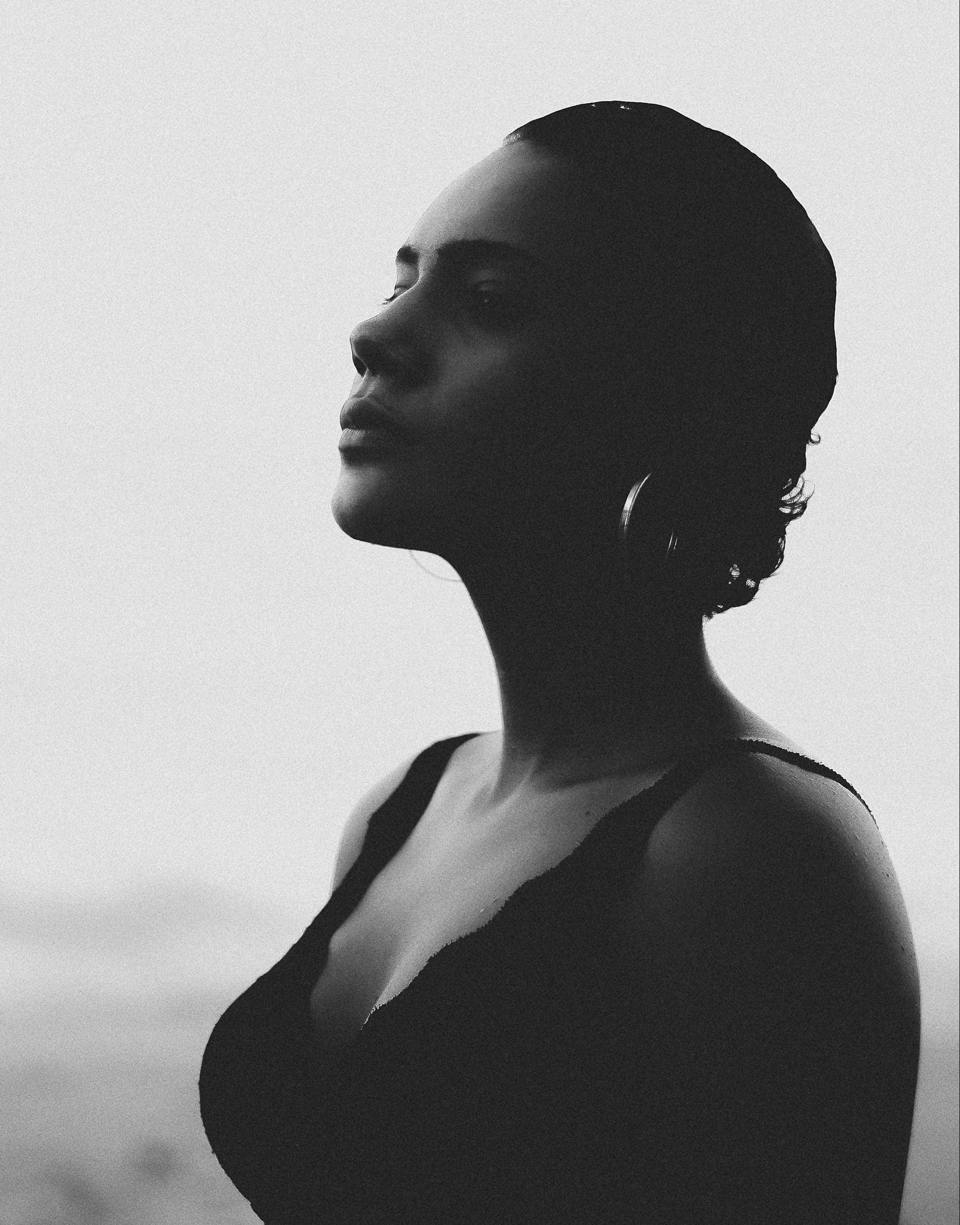 woman of color staring off into distance