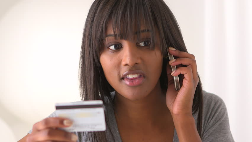 black woman with credit card
