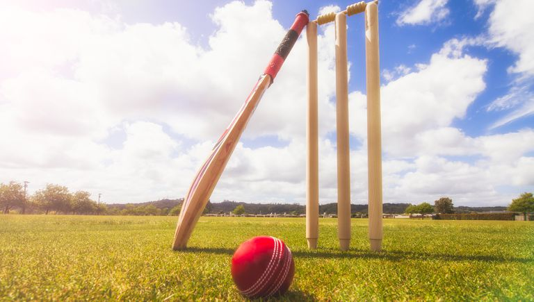 cricket-bat-ball-and-wickets-in-cricket-ground