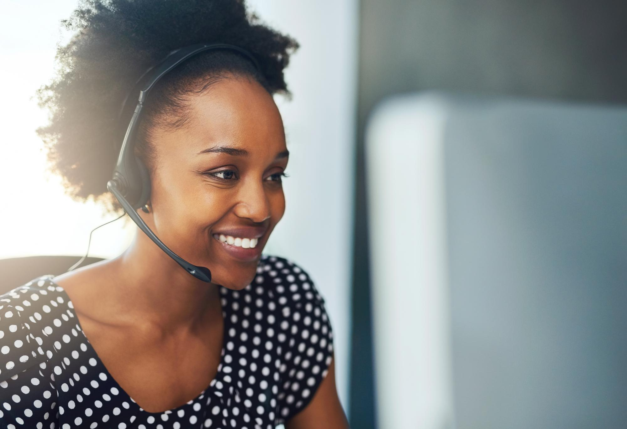 black-woman-on-business-call-smiling