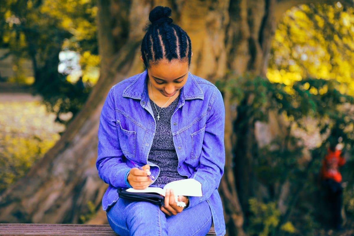 black-woman-writing-in-journal