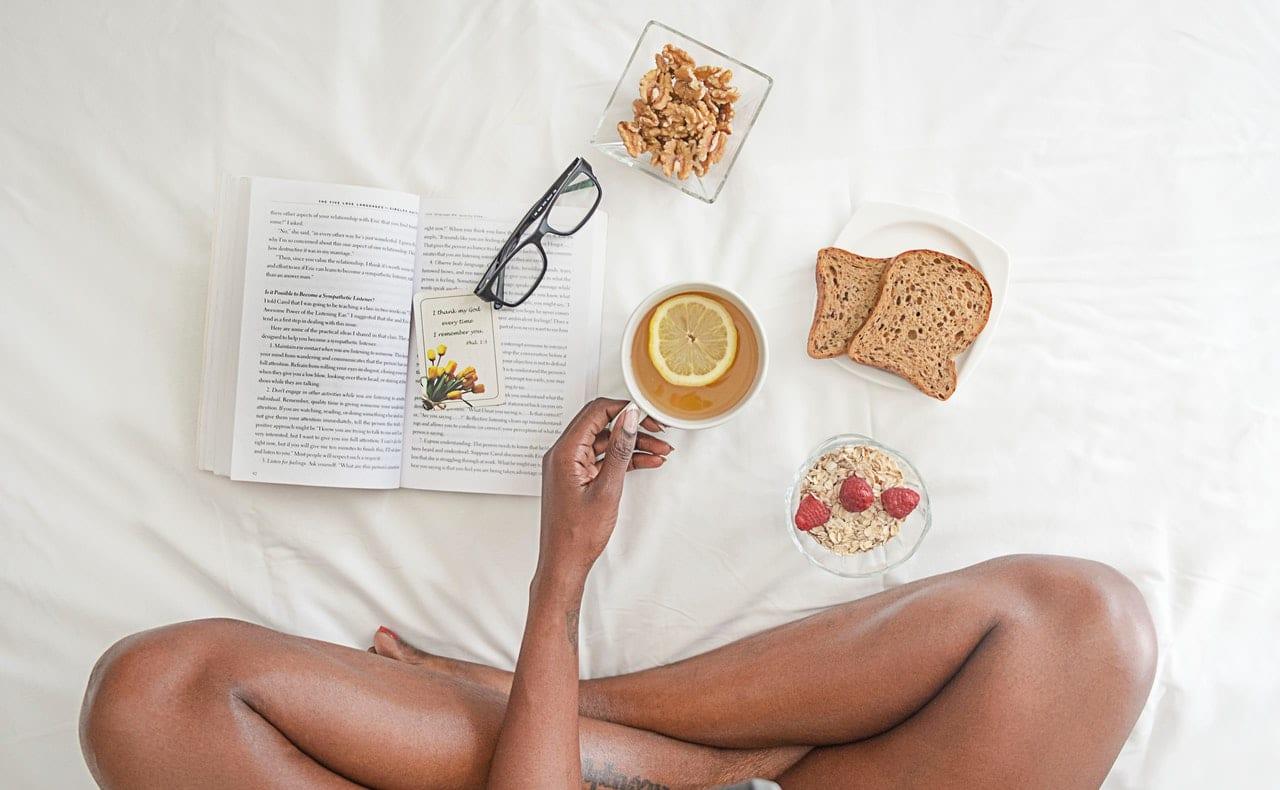 black-woman-on-bed-with-mug