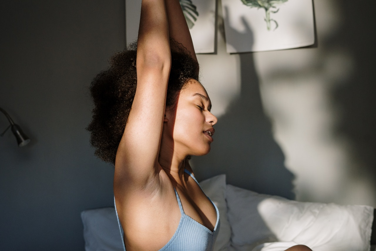 black-woman-stretching-relaxing-waking-up