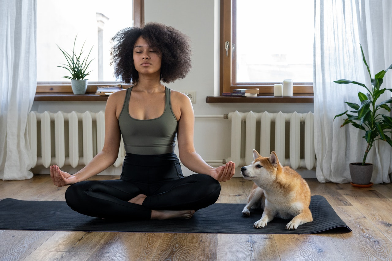 black-woman-doing-yoga-with-dog