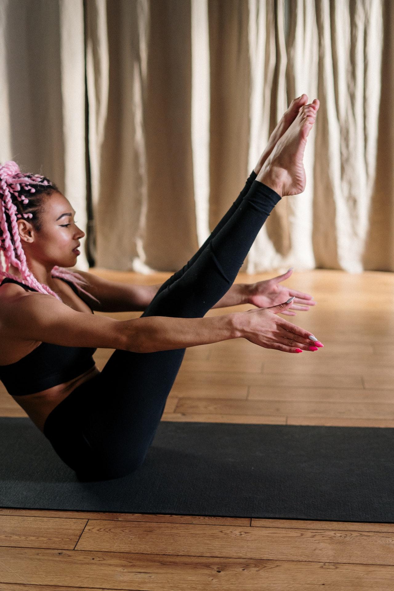 black-woman-yoga-exercising-at-home