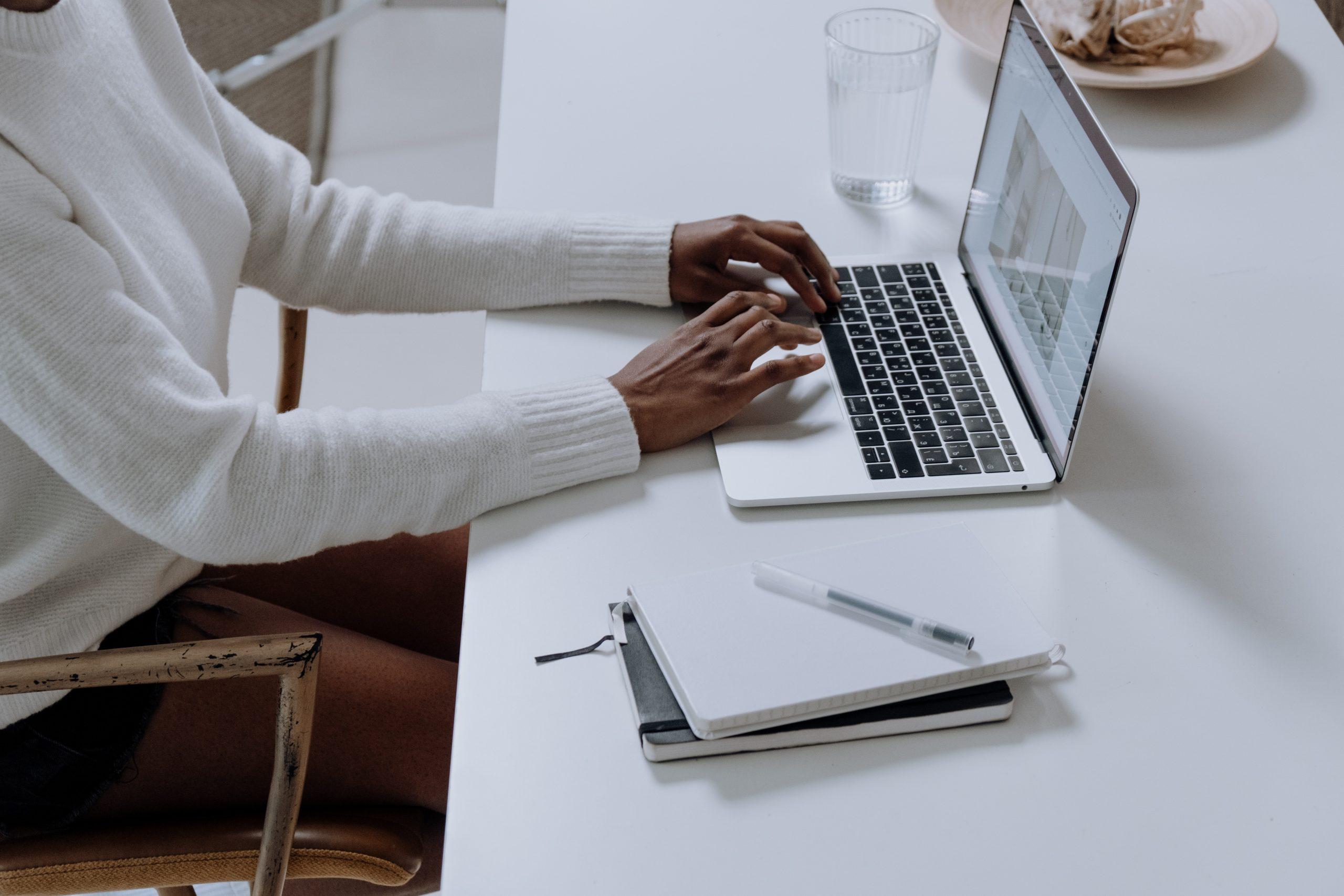 black-woman-typing-laptop-website