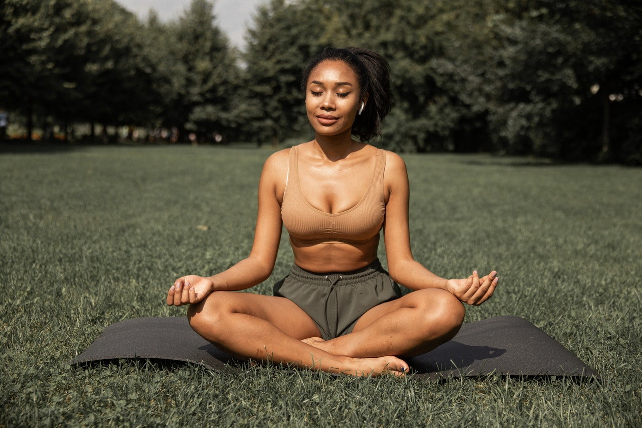 black-woman-meditating-on-grass