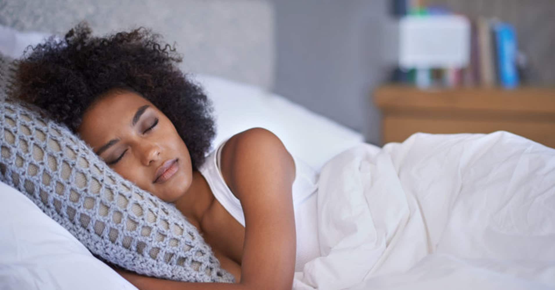black woman sleeping in bed sleep