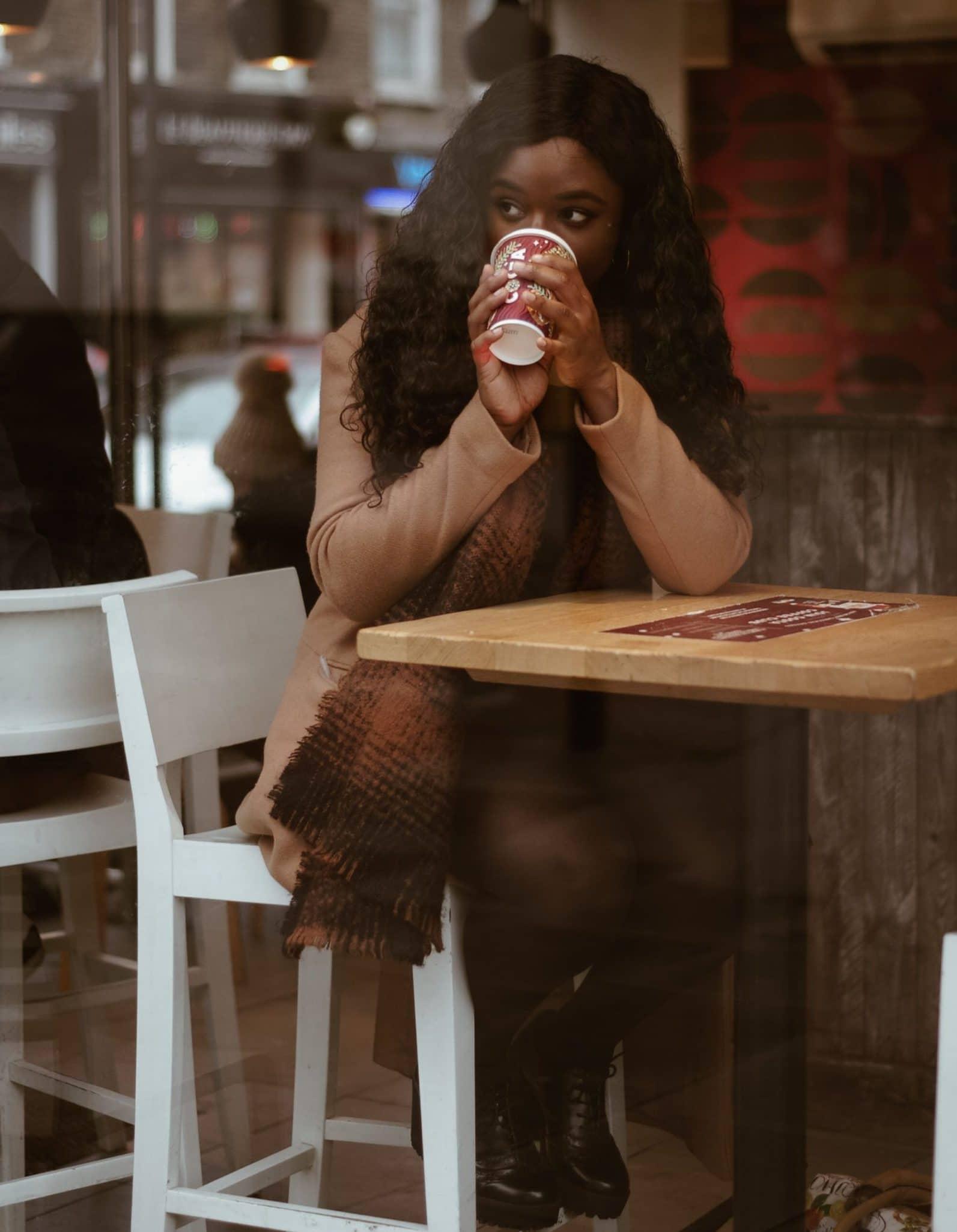 black woman at coffee shop