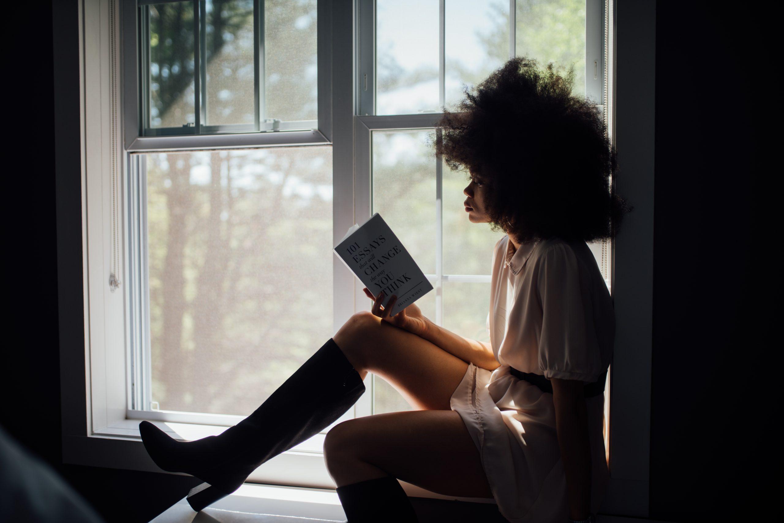 black woman reading a book