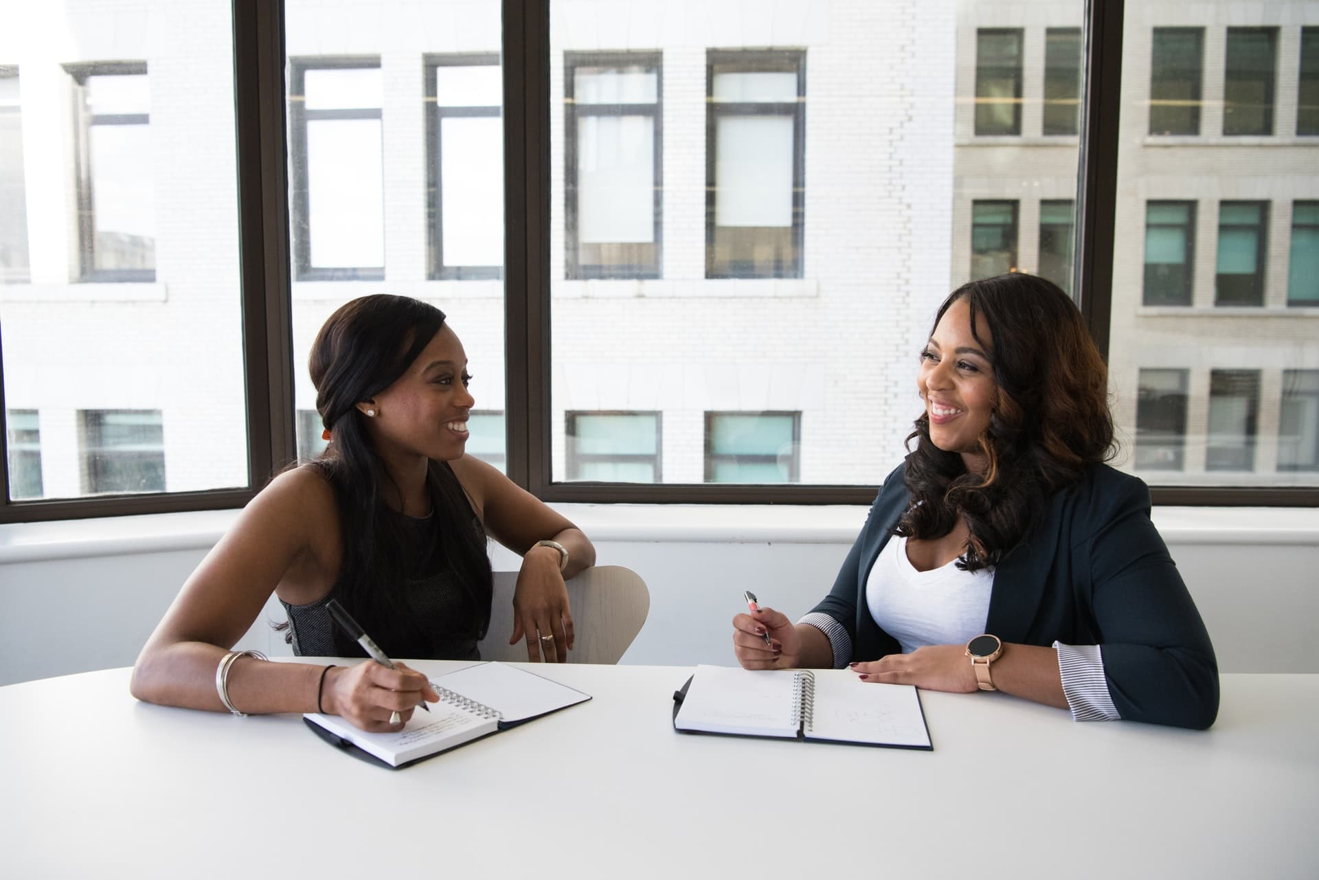two black women in business meeting