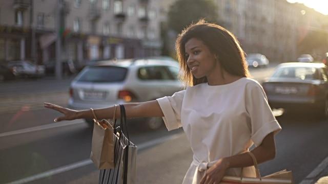 black woman hailing a cab
